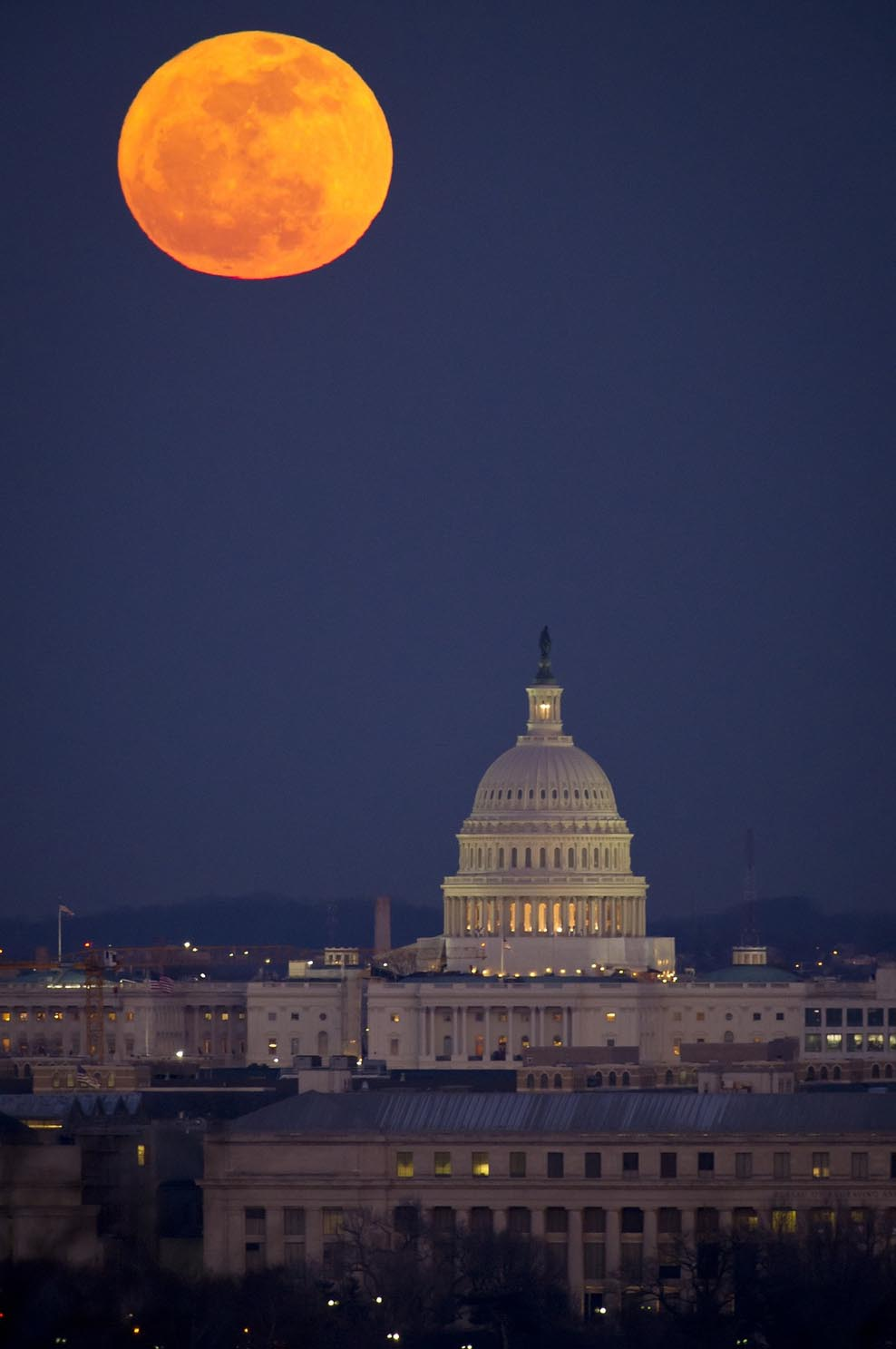 The Government Capitol building under a full moon