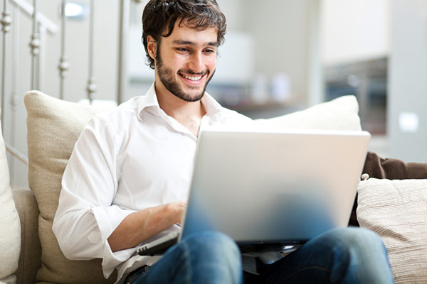 Student on laptop taking online classes.