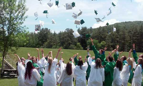 Accounting graduates throwing caps in the air