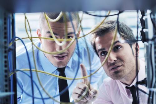 IS professionals fixing a server